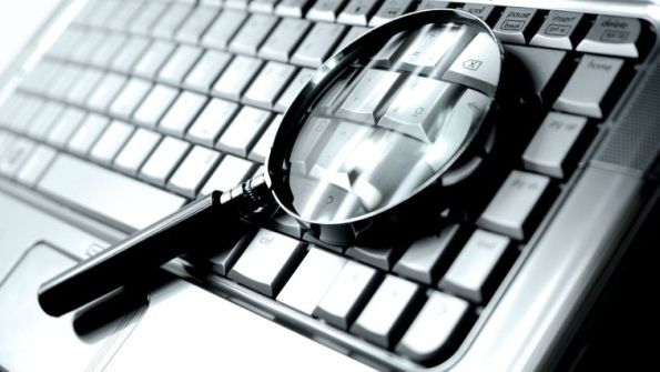 magnifying-glass-laptop-595x335